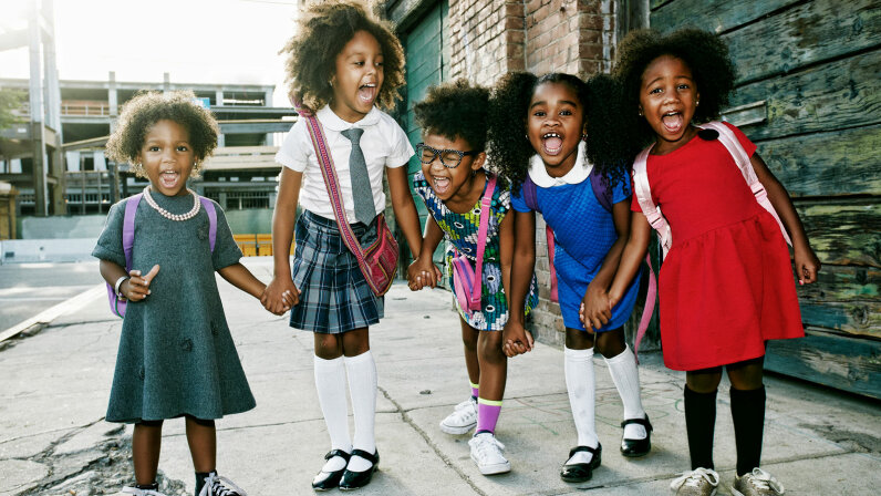 black girls standing on street smiling