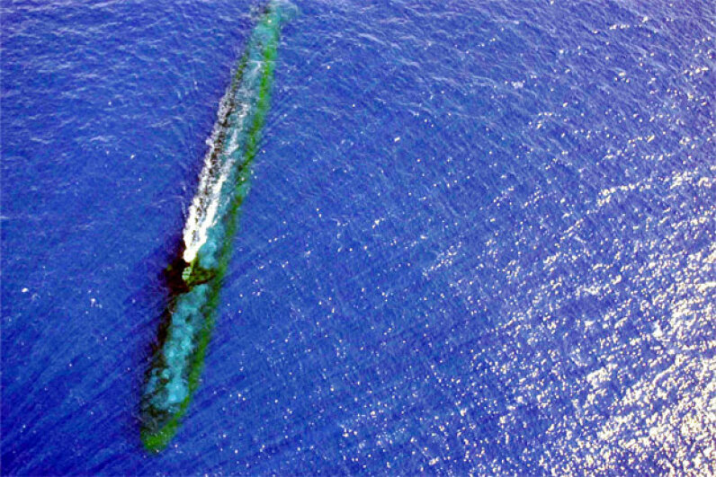 The Los Angeles Class Attack submarine USS Chicago (SSN 721) completes a training maneuver off the coast of Malaysia in July 2001. Kind of makes you realizes how friction could be a very formidable force for a beast like that. Image courtesy U.S. Navy/Photographer's Mate 1st Class Kevin H. Tierney