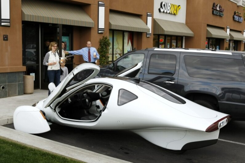 The Aptera 2e takes a break from being aerodynamic to grab some coffee at Starbucks. Aptera Motors eventually folded in December 2011. © Mike Blake/Reuters/Corbis