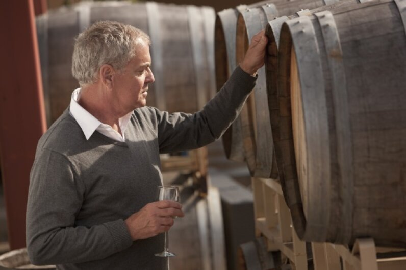 If you swirl, sniff and sip every time you pick up a glass of wine, you might enjoy being a winemaker. © John Fedele/Blend Images/Corbis