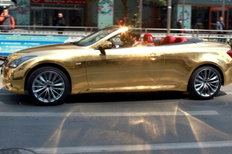 While all of the cars you drive may not be as flashy as this gold-plated sports car, your need for speed and lavish autos will definitely be satisfied as a luxury car test driver. STR/AFP/Getty Images