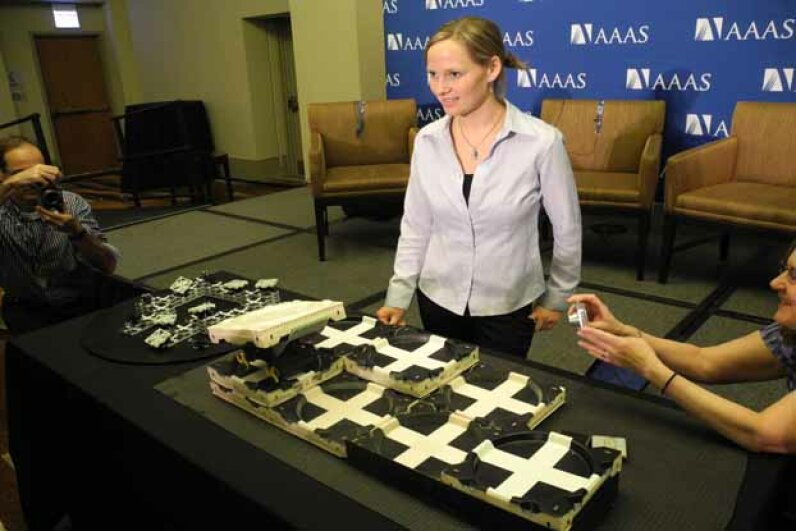 Kirstin Petersen, an academic fellow in artificial intelligence at Harvard University, demonstrates robots inspired by termites at the American Association for the Advancement of Science meeting in Chicago in 2014. KERRY SHERIDAN/AFP/Getty Images