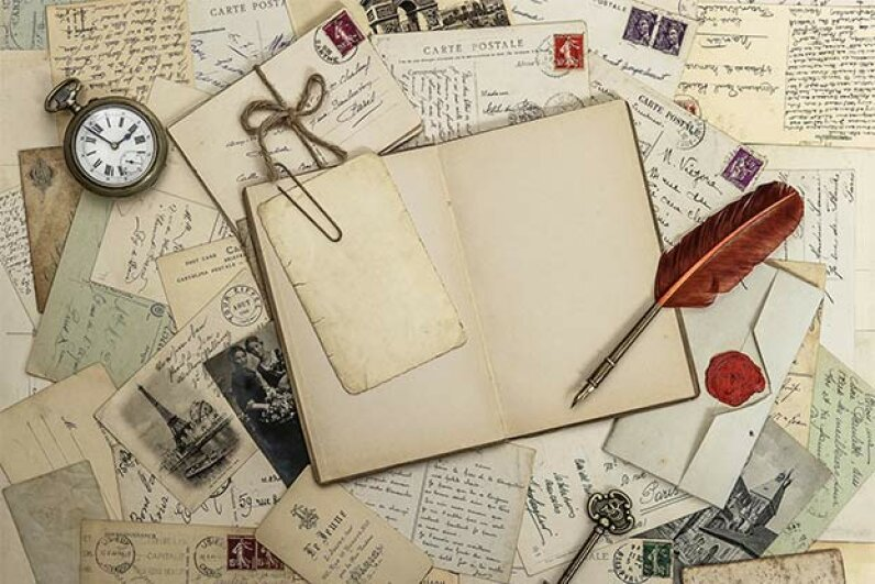 A heritage scrapbook can paint a unique and memorable picture of your family. LiliGraphie/iStock/Thinkstock