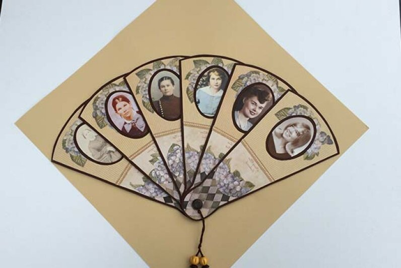 This Victorian-style fan was created by Nancy Merrill to show six generations of women in her family. Nancy Merrill