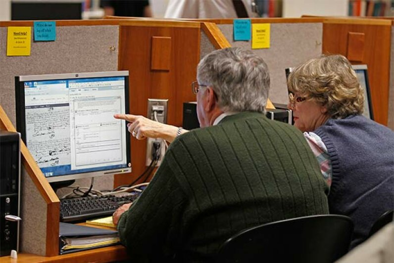 People research genealogy records in the Family History Library of the Church of Jesus Christ of Latter-Day Saints on the campus of Brigham Young University in Provo, Utah. © GEORGE FREY/Reuters/Corbis