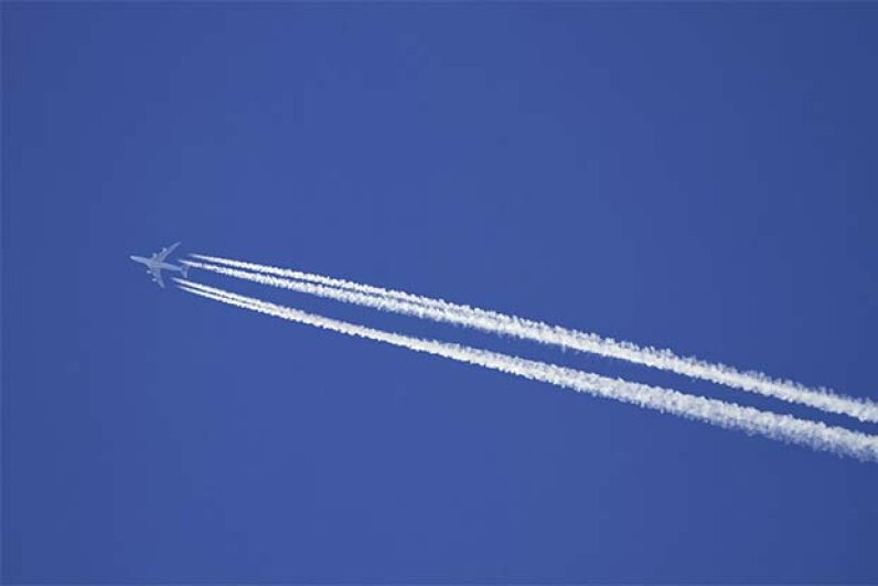 The contrails made by airplane exhaust are thought by some conspiracy theorists to actually be trails of chemical agents designed to harm people. AnetteAndersen/iStock/Thinkstock
