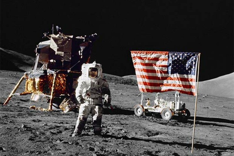 Pilot Harrison H Schmitt stands on the lunar surface near the U. S. flag during NASA's lunar landing in 1972. Some conspiracy theorists think all moon landings were faked because a flag couldn't wave in a windless place.  Universal History Archive/Getty Images