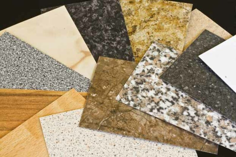 Kitchen countertops can be made of many types of materials, including recycled paper. iStock/Thinkstock