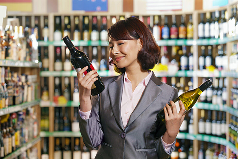 Dropping one of those bottles will be enough to snap her out of that wine-related reverie. XiXinXing/iStock/Thinkstock