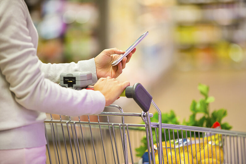 Be aware. If you need to text at the store, do it out of the way of other shoppers. LDProd/iStock/Thinkstock