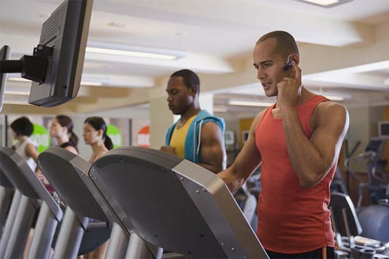 If you've got to take a call while on the treadmill, keep it short and your voice down. Jupiterimages/Stockbyte/Thinkstock