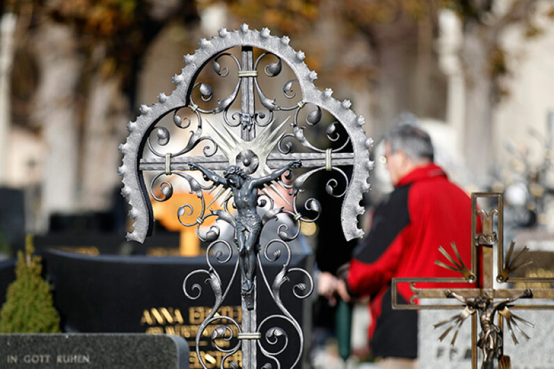 Catholics in Austria mark All Saints' Day by visiting the gravesites of loved ones — and leaving out bread and water for their spirits at home. © DOMINIC EBENBICHLER/Reuters/Corbis