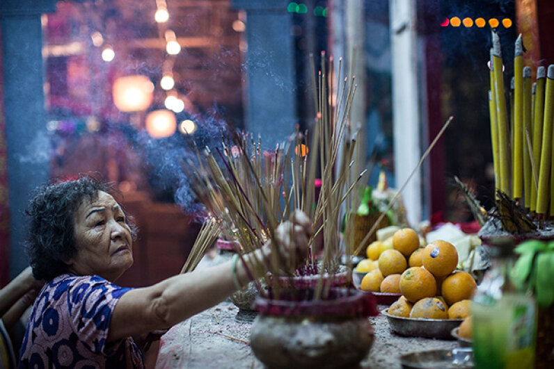 A worshipper makes offerings at a park during the Hungry Ghost Festival on Aug. 14, 2015 in Hong Kong. Lam Yik Fei/Getty Images for Hong Kong Images)