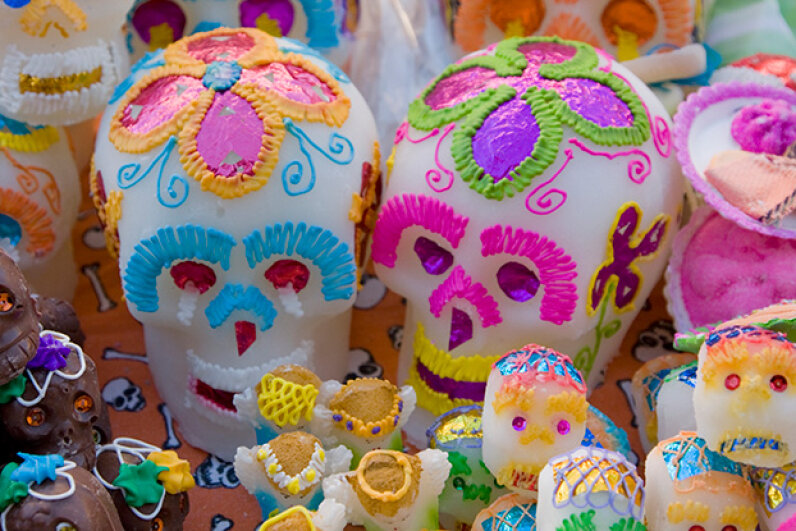 Each sugar skull represents a departed soul and is made of sugar paste. Although they can be eaten, the skulls normally just decorate a home altar or gravesite. Danita Delimont/Gallo Images/Getty Images