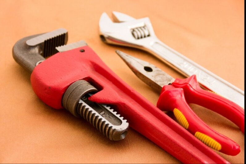 Adjustable wrenches are workhorses -- most well-appointed tool kits will have more than one. ©iStockphoto.com/MrLonelyWalker