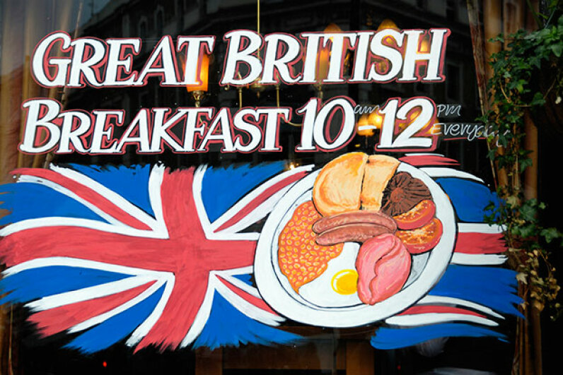 This sign in a British pub advertises a 'Great British Breakfast' featuring lots of protein in the form of bacon, eggs, sausages and beans. Roberto Herrett/Getty Images