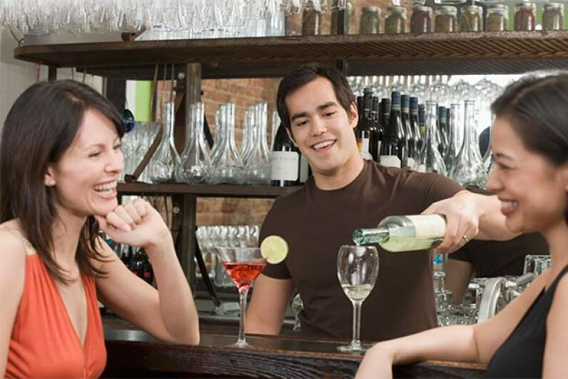 Who's more likely to have a hangover, the wine-drinker or the martini-sipper? It depends. Fuse/Thinkstock