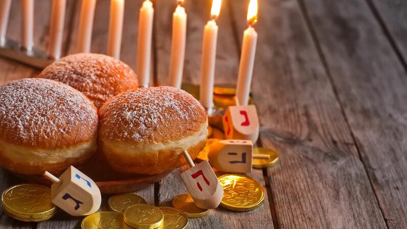 hanukkiah, doughnuts and dreidels