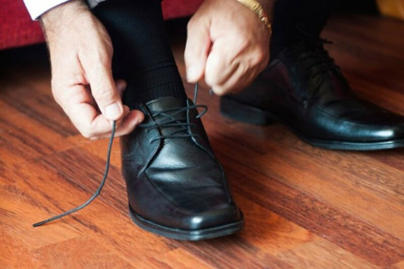 By simply reversing the direction of one lace-tying step, you'll create a more stable knot. ©iStockphoto/Thinkstock