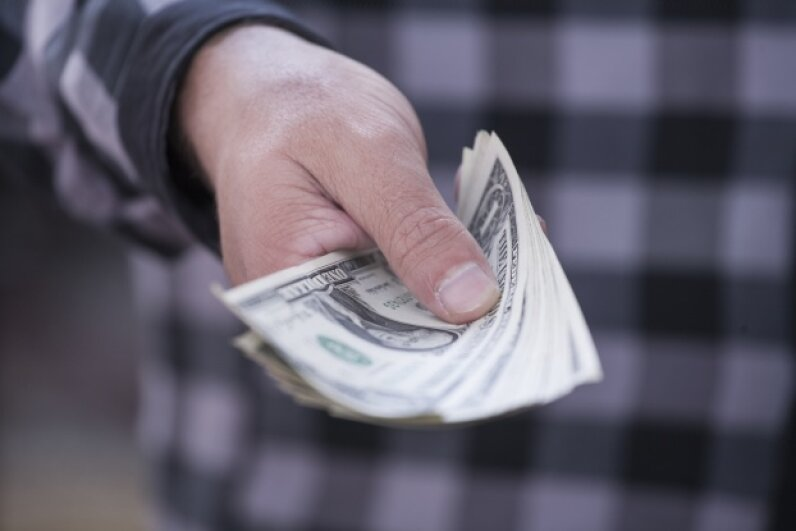 """""""Here's all that money I owe you. I even threw in some bacteria free of charge."""" iStockphoto/Thinkstock"""