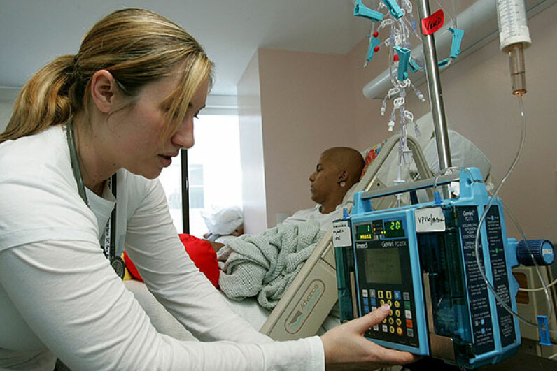 Nurse Autumn Small adjusts an IV drip machine for a patient receiving treatment for a rare form of cancer at a children's hospital in San Francisco, 2005. Health care costs a lot more in the U.S. than in other developed countries. Justin Sullivan/Getty Images