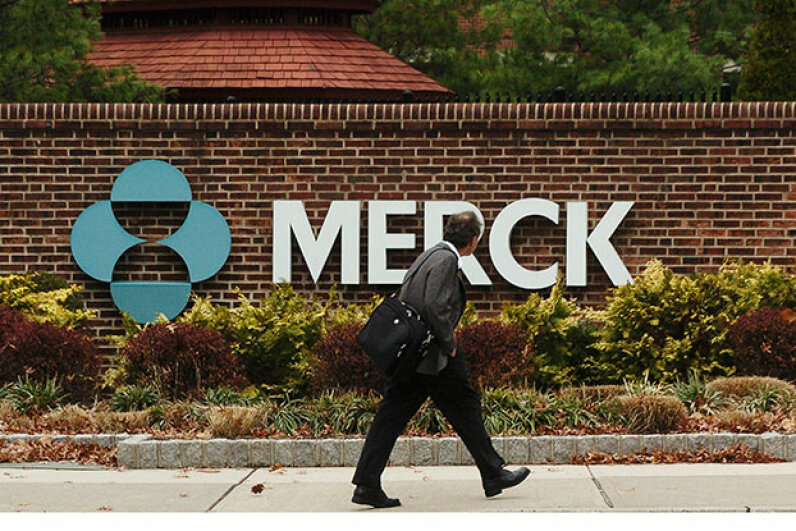A man walks by a  Merck plant in Rahway, New Jersey in 2005. Drug companies have much higher profit margins than health insurance companies. Marko Georgiev/Getty Images