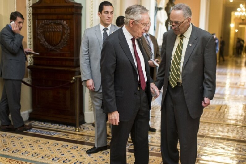 Senate Majority Leader Harry Reid, D-Nev., and Sen. Charles Schumer, D-N.Y. on Nov. 14, 2013 as they leave the Senate Democrats' meeting on Obamacare with White House Chief of Staff Denis McDonough. © Bill Clark/CQ Roll Call/Getty Images