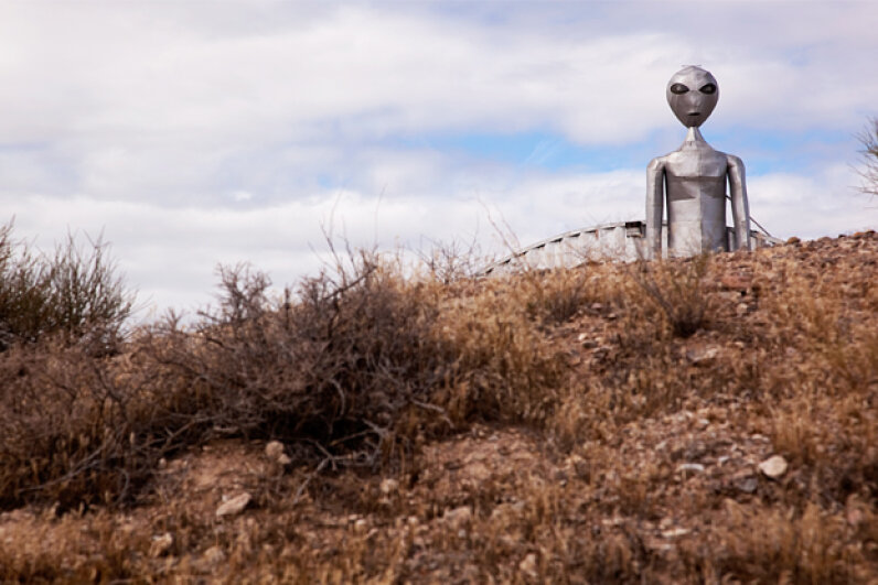 A statue of an alien stands guard over the Nevada highway near the Area 51 base. © Martyn Goddard/Corbis
