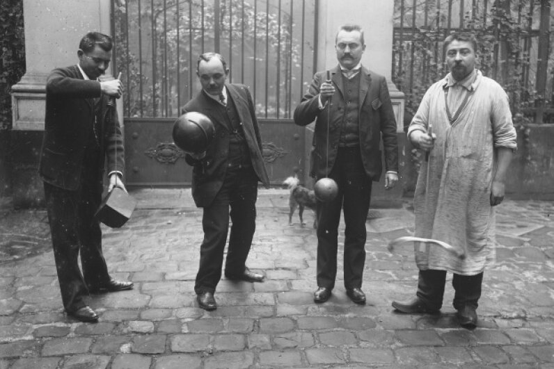 A group of men play cup and ball in 1906.  Branger/Roger Viollet/Getty Images