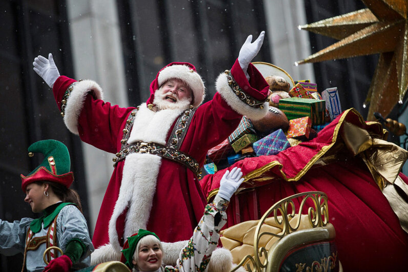 Santa Claus waves to the crowd during the Macy's Thanksgiving Day Parade in New York City. This traditionally marks the beginning of Christmas but stores are way ahead of the game, much to some people's dismay. Andrew Burton/Getty Images