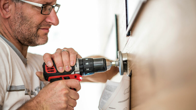 handyman using a drilling machine