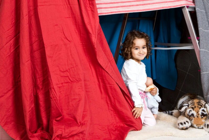 Why rely on unstable homemade items? Some companies sell kits of poles and joints made exclusively for building play forts. Halfdark/Getty Images