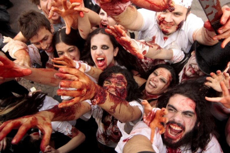 Horror movies have become so interwoven with popular culture that we have thousands of spinoff events, like this 2010 zombie walk. Rodrigo Coca/FotoArena/LatinContent/Getty Images