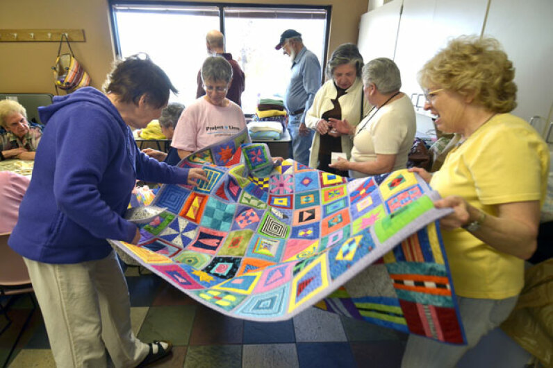 An Albuquerque, N.M. Project Linus group, shown here at the Bear Canyon Senior Center, donates nearly 4,000 homemade blankets to those in need each year.  © Albuquerque Journal/ZUMA Press/Corbis