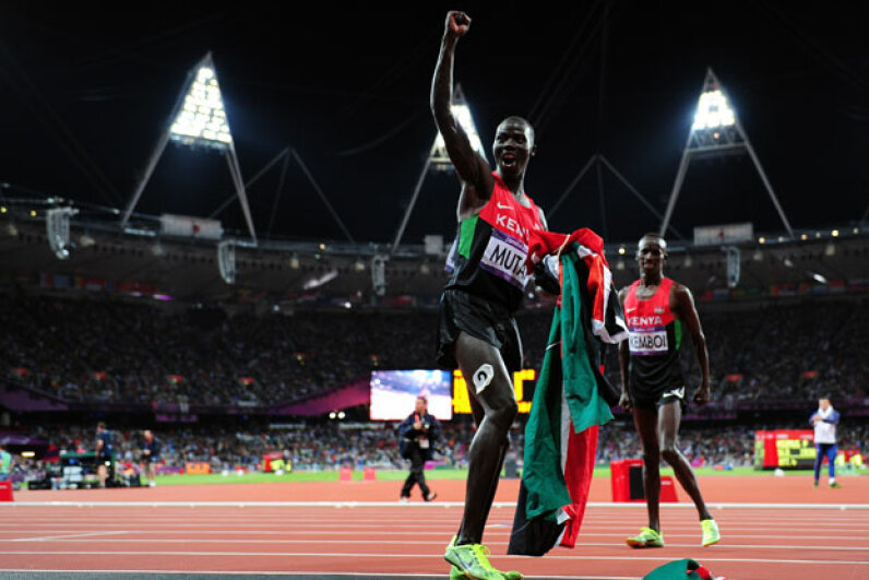Abel Kiprop Mutai of Kenya celebrating his bronze medal run after the Men's 3000m Steeplechase on August 5, 2012 at the London 2012 Olympic Games.  © Stu Forster/Getty Images