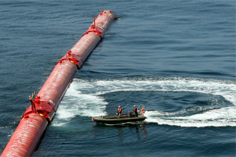 An electricity generator based on wave power sits off of Portugal's coast in 2008. A technical glitch forced the wave energy farm offline after two months. It used floating tubes whose bobbing motion pumped hydraulic fluid to drive generators. Joao Abreu Miranda/AFP/Getty Images