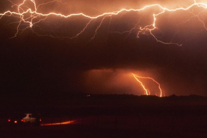 During a lightning storm, you might not be as safe in your car as you think. Fuse/Thinkstock