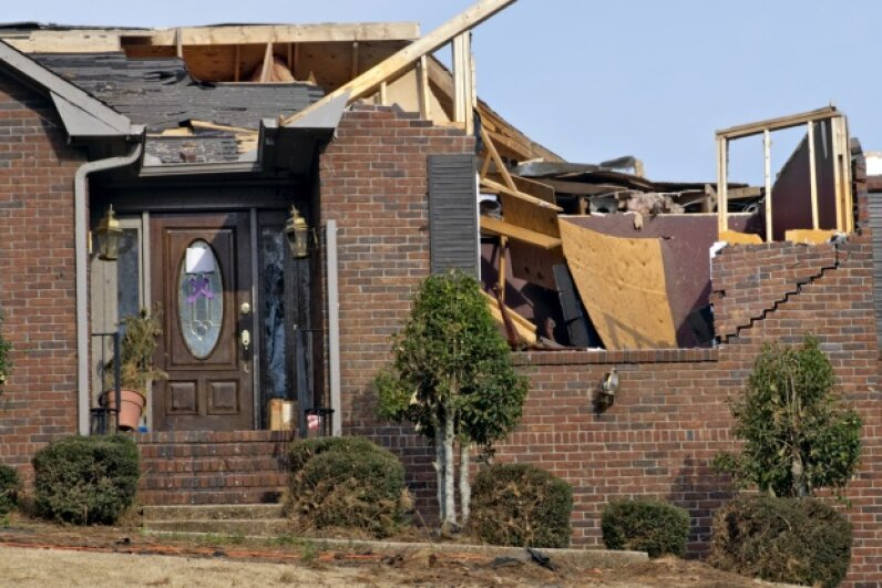 Opening a window during a tornado has the potential to cause way more harm than good. Laura Clay-Ballard/iStock/Thinkstock