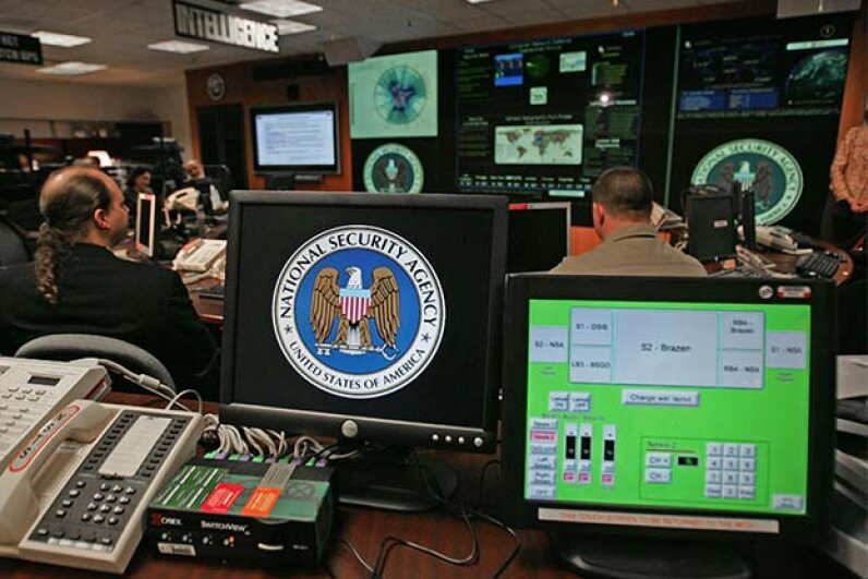 A computer workstation bears the National Security Agency (NSA) logo inside the Threat Operations Center at the NSA in 2006. PAUL J. RICHARDS/AFP/Getty Images