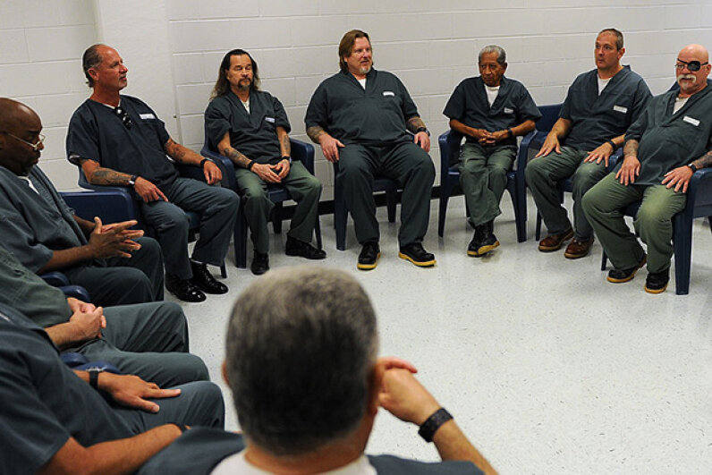 Inmates, who have spent most of their lives behind bars, gather to talk about surviving on the outside. Studies show that native-born Americans are jailed at about twice the rate of immigrants, refuting the myth that immigrants commit more crime. RJ Sangosti/The Denver Post via Getty Images