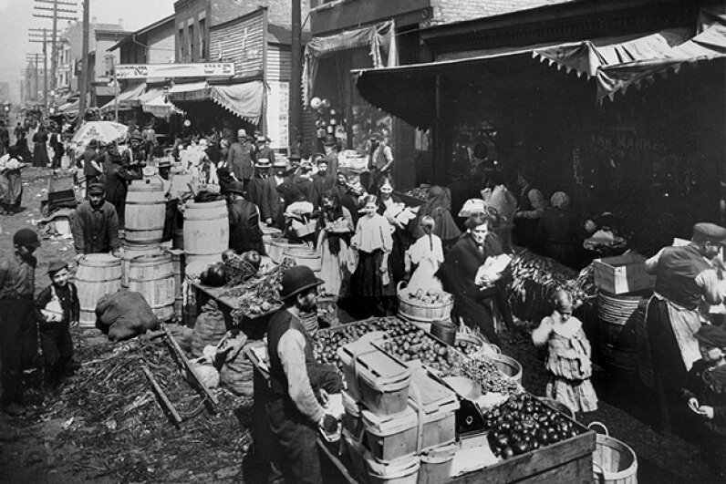 A view of the Maxwell Street Market in Chicago, ca. 1915. The Maxwell Street neighborhood in Chicago was a haven for new arrivals from the mid-1800s. Chicago History Museum/Getty Images