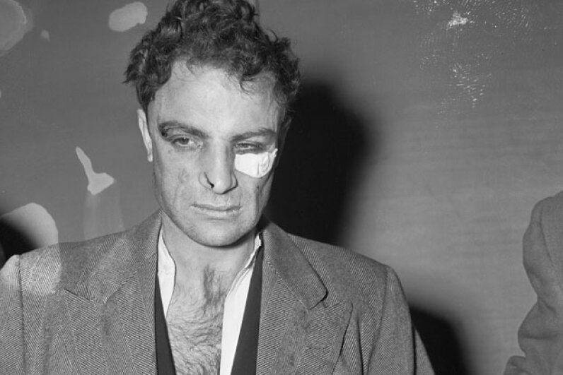 Anthony Esposito on Jan. 16, 1941, as he was brought before a police identification line-up. © Bettmann/CORBIS