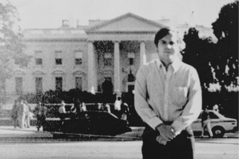 John Hinckley, Jr. standing across the street from the White House in 1981. © Bettmann/CORBIS
