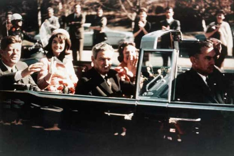 President John F. Kennedy and his wife Jacqueline and Texas Governor John Connally and his wife Nellie ride through the streets of Dallas just before Kennedy's assassination on Nov. 22, 1963. Many mysteries still remain about that fateful day. See pictures of American politics in souvenirs and slogans. © CORBIS