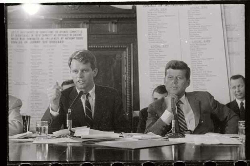 "Robert Kennedy (left) questions James R. (""Jimmy"") Hoffa during a hearing of the Senate Labor Rackets Committee in 1957 while then-Sen. John Kennedy looks on. © Bettmann/CORBIS"