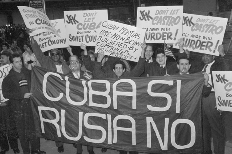 Anti-Castro demonstrators hold up signs near the Waldorf-Astoria hotel, in New York City in 1961. This was to coincide with Kennedy's arrival there for a speech. Like their arch-foe, anti-Castro forces were considered possible conspirators. © Bettmann/CORBIS