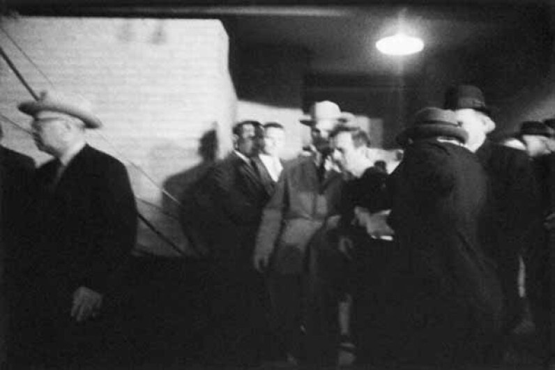 Jack Ruby shoots Lee Harvey Oswald as he is escorted from Dallas police headquarters. © Bettmann/CORBIS