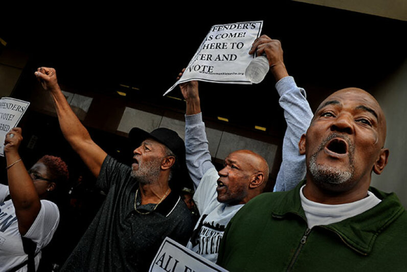 Former prisoners demonstrate at a rally for felon voting rights in Baltimore, Maryland. The state changed its law so that felons got their voting rights back after serving their prison sentences instead of having to complete parole and probation as well. Michael S. Williamson/The Washington Post via Getty Images