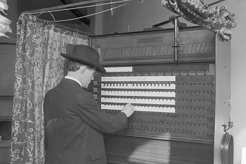 A man votes in Chicago in 1906, using a lever. In the North at that time, officials sought to keep immigrants and ethnic and religious minorities from voting, often by changing registration dates or demanding they show original naturalization papers. Chicago History Museum/Getty Images