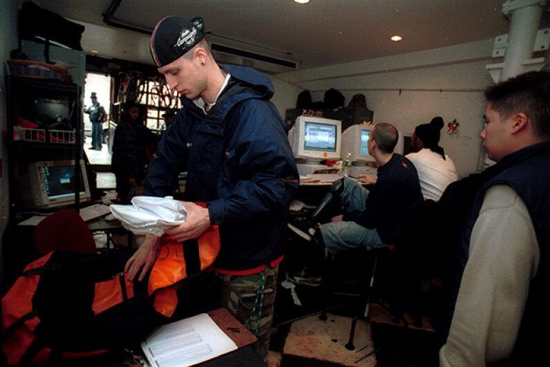 A Kozmo.com messenger prepares deliveries a New York City distribution center in February 2000. Chris Hondros/Getty Images